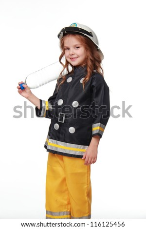 Studio image of kid in firefighter costume - stock photo