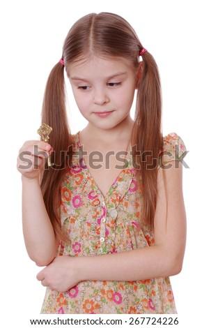 studio image of lovely girl holding golden vintage old key isolated over white background - stock photo