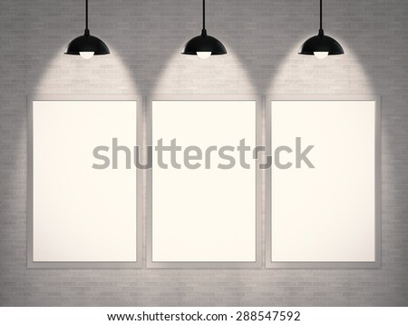 studio interior with empty frames hanging on grey wall  - stock photo