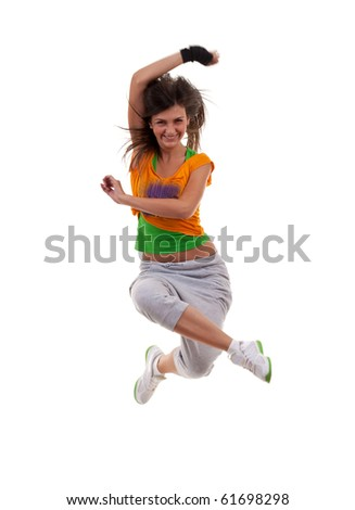 Studio isolated. Dancing woman with brown long hair and happy smiling facial expression jumping up.