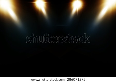 Studio Lighting against a dark background - stock photo