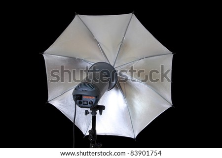 studio lights umbrella isolated on black - stock photo