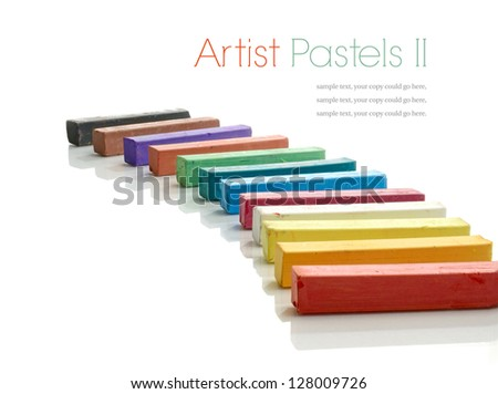 Studio macro of a selection of colorful artists pastels on a white background with soft shadows. Copy space.