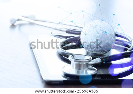 Studio macro of a stethoscope and texture globe with digital tablet with shallow DOF evenly matched abstract as medical network concept - stock photo