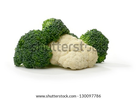 Studio macro of brocolli and cauliflower with soft shadows on a white surface. Copy space. - stock photo