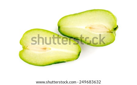 Studio macro of Chayote fruit chopped in half - stock photo
