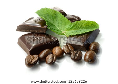 Studio macro of chocolate, fresh mint leaves and coffee beans. Copy space. - stock photo