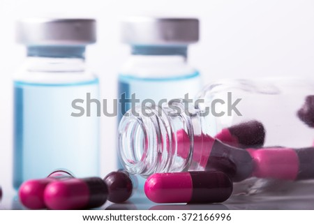 studio photo medical drugs to treat people in background
