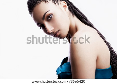 Studio photo of a beautiful mulatto girl in fashion dress on white background.