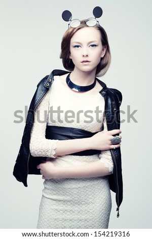 Studio photo of a beautiful young woman - stock photo