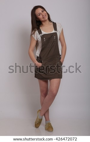 studio photo of a girl in olive skirt