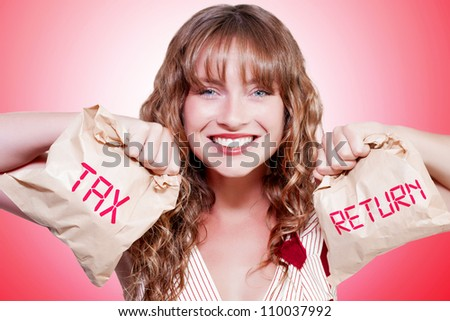 Studio Photo Of A Happy Woman Smiling With Brown Paper Bags Stuffed With Money In A Accounting Income Tax Return Concept - stock photo