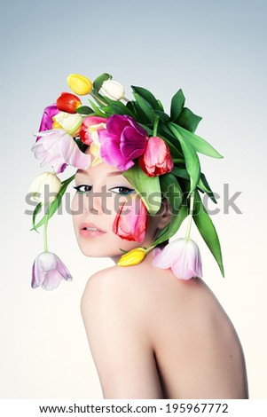 Studio photo of a young woman with wreath of roses. - stock photo