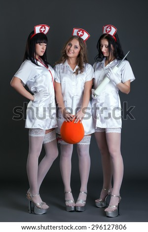 Studio photo of girls dressed as sexy nurses - stock photo