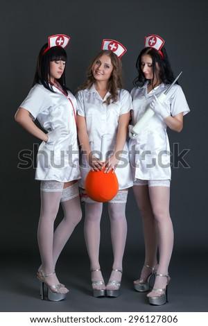 Studio photo of girls dressed as sexy nurses - stock photo
