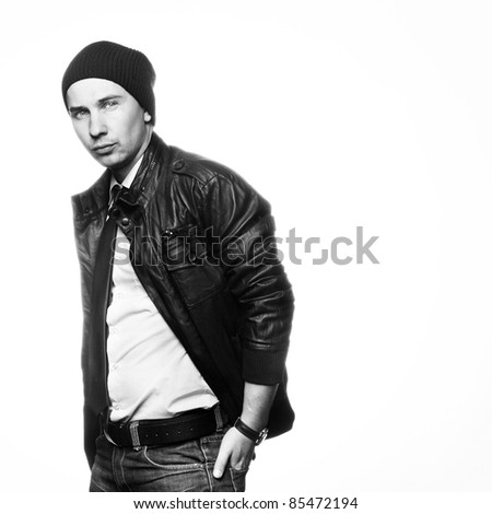Studio photo of trendy young man standing on white background - stock photo