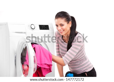 Studio photo of woman launderers clothes - stock photo