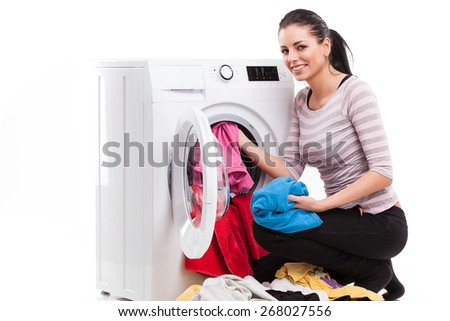 Studio photo of woman launderers clothes isolated over white background