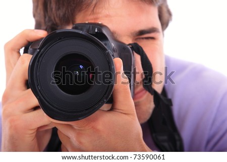 Studio photographer taking pictures isolated over white background - stock photo
