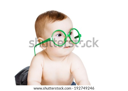 Studio photography. Little baby boy in the big funny glasses. isolated on white background - stock photo