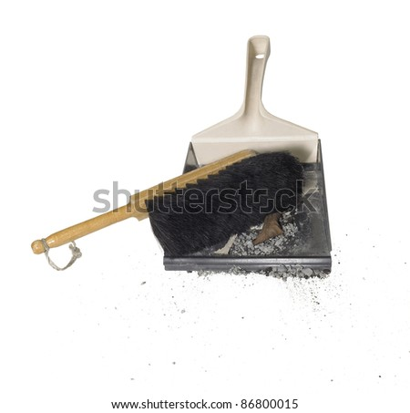 studio photography of a dustpan and dirt in white back