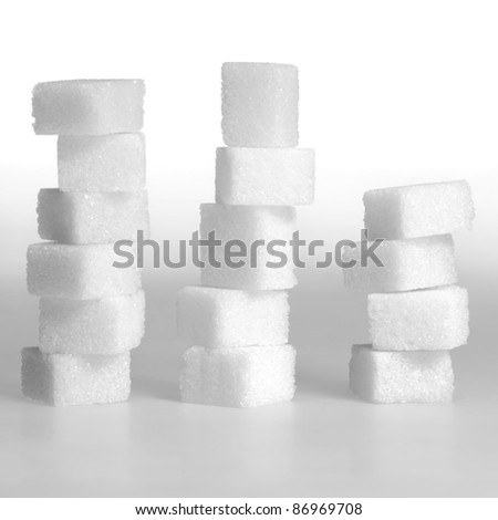 Studio photography of 3 lump sugar stacks in light gradient back