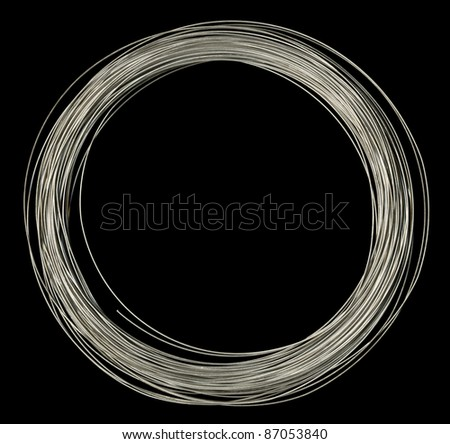 studio photography of rolled silver wire in black back - stock photo