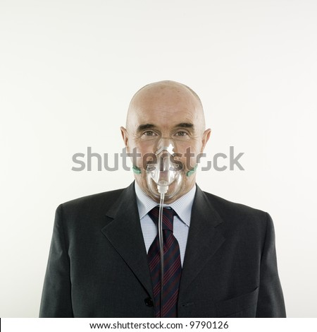studio portrait isolated on white background of a man senior with a oxygen mask - stock photo