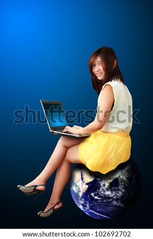 Studio portrait lady on Globe : Elements of this image furnished by NASA - stock photo