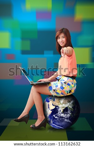 Studio portrait lady on globe isolated : Elements of this image furnished by NASA