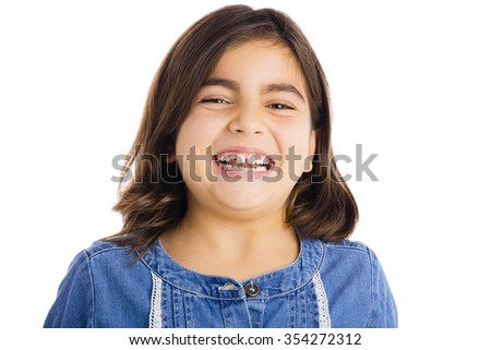 Studio portrait of a beautiful girl smiling, isolated over white background