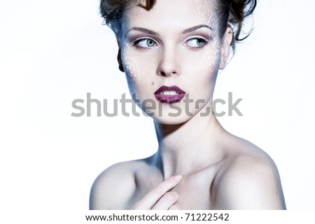 Studio portrait of a beautiful sexy brunette woman with perfect makeup and hair