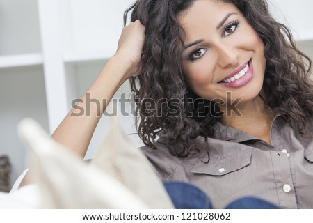 Studio portrait of a beautiful young Latina Hispanic woman smiling - stock photo