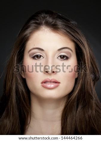Studio portrait of a beautiful young woman - stock photo
