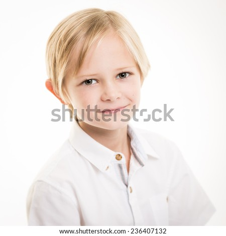 Studio portrait of a blond boy with blue eyes wearing a white smart shirt isolated against a white background - stock photo
