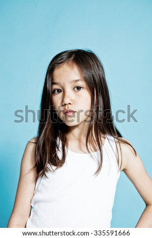 Studio portrait of a girl on a blue background - stock photo
