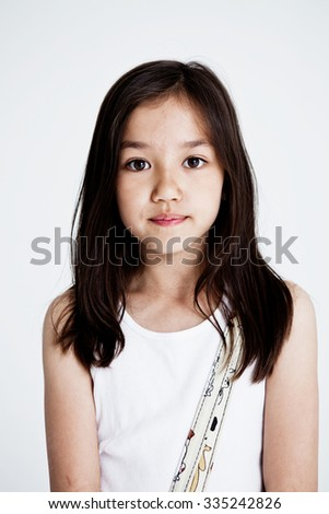 Studio portrait of a girl on a light background - stock photo
