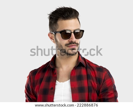 Studio portrait of a handsome young man  - stock photo