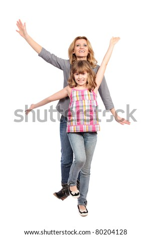Studio portrait of a happy mother and daughter isolated on white background - stock photo