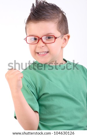 studio portrait of a kid celebrating a victory with confidence - stock photo