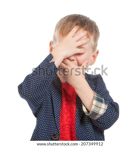Studio portrait of a kid covering face with hands, isolated - stock photo