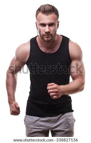studio portrait of a male athlete running isolated on white background - stock photo