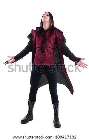 studio portrait of a man dressed as a vampire - stock photo