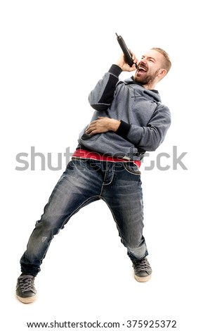 studio portrait of a man singing with microphone isolated on white background, a nice young man with blond hair singing with drive. - stock photo