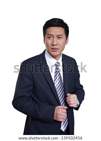 studio portrait of a mid-adult asian businessman making a fist. - stock photo