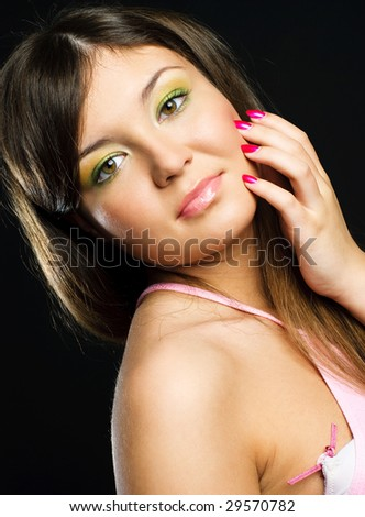 studio portrait of a pretty brunette model with colorful makeup and beautiful nails - stock photo