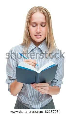 Studio portrait of a pretty young woman with blue book and pen on a white isolated background
