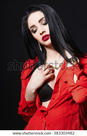 Studio portrait of a sexy hot brunette girl with full red lips