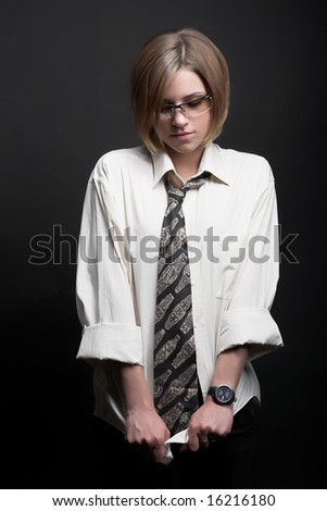 Studio portrait of a woman in men's clothes - stock photo