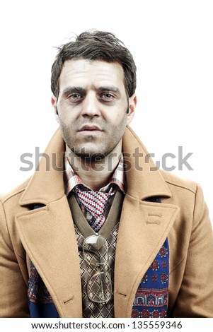 Studio portrait of a young adult man (mid 20's) wearing old-man clothes and makeup, and giving the camera a tired/exhausted/sad/depressed/numb gaze. Isolated on white background. - stock photo